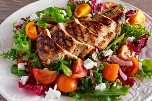 A healthy salad with BBQ chicken cooked to perfection.